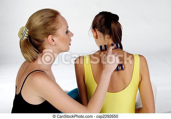 Stock Photography of Massage - Two girls massaging each
