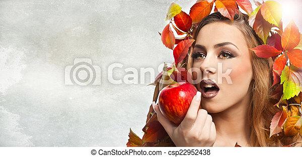 Autumnal model eating apple
