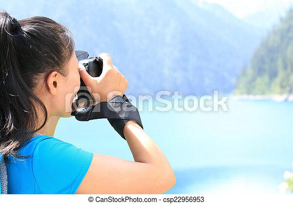woman photographe taking photo