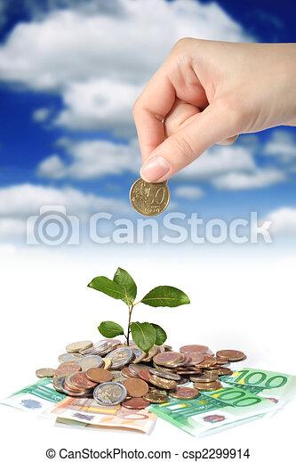 Plant hand and money. - csp2299914