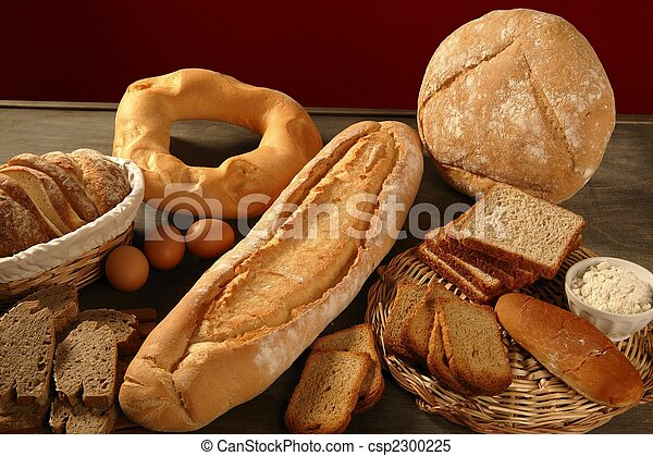 Bread still live over dark wood background - csp2300225