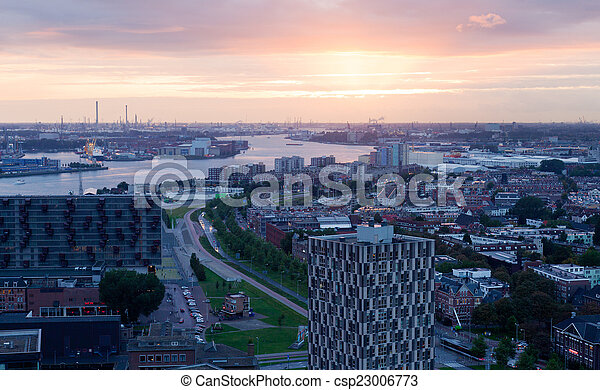 View of Rotterdam from height of bird's flight on a sunset - csp23006773