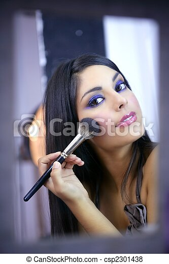 Indian fashion model makeup with brush - csp2301438