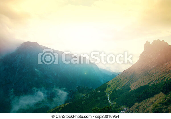 Fog in mountains. Fantasy and colorfull nature landscape. Nature conceptual image.