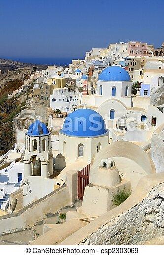 Orthodox Church with blue cupolas fom Santorini, Greece  - csp2303069