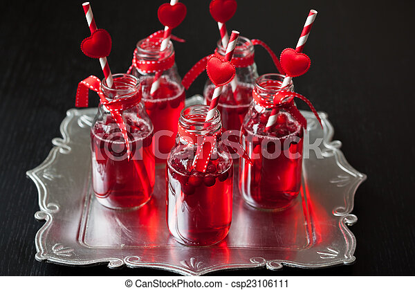 small bottles with cranberry cocktail