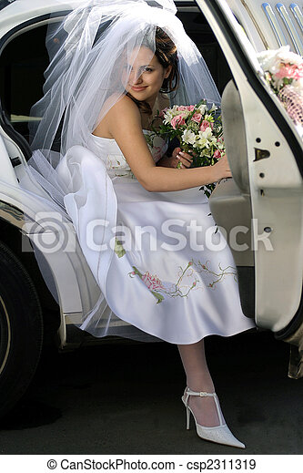 Smiling bride in wedding car limo - csp2311319