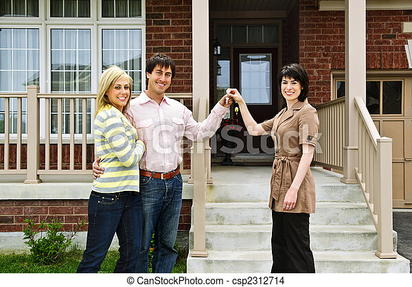 Happy couple with real estate agent - csp2312714