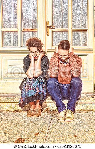 depressed and agitated man and woman crouching in front of the h