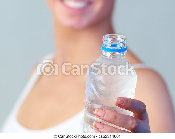 Close-up of a woman with a bottle of water with focus on water - csp2314601