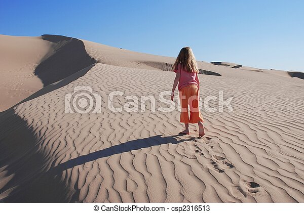 Little Girl Wandering Alone in Sand Dunes - csp2316513