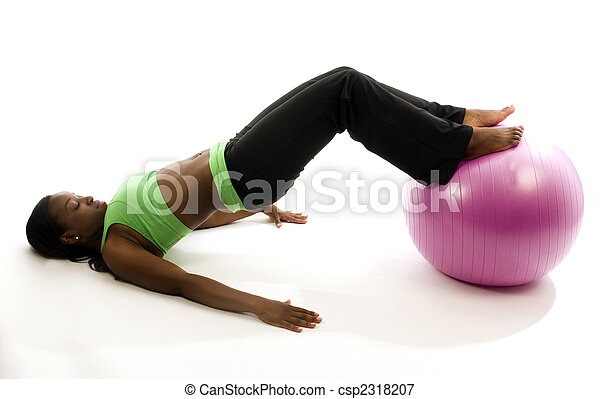 young and pretty hispanic latina black woman wearing exercise tights and working out sit ups with fitness core ball - csp2318207