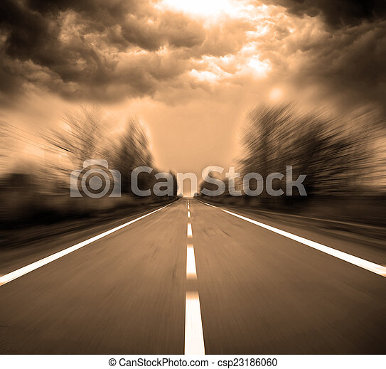 Blurred Road with blurred sky and sunset