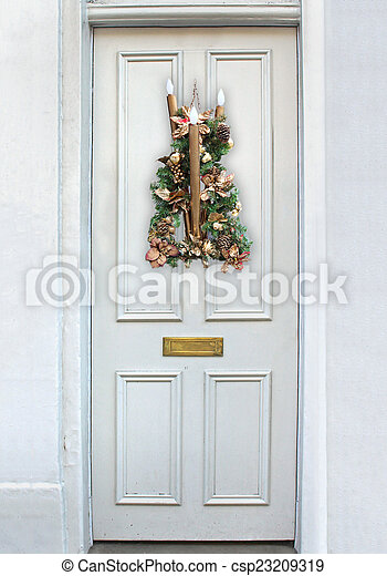 White residential door decorated with Christmas ornament for festive season