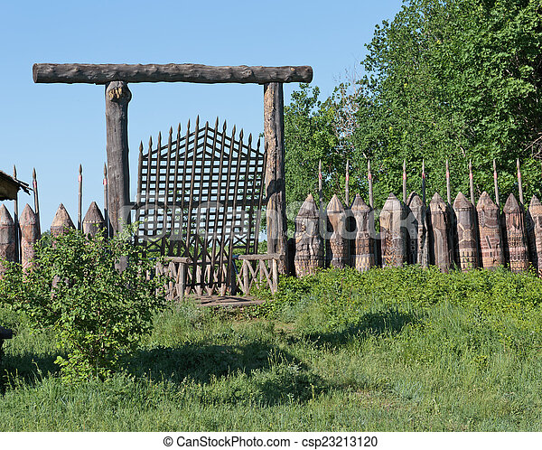 Stock photo of old wooden fortification wall of the fort for Old wooden forts