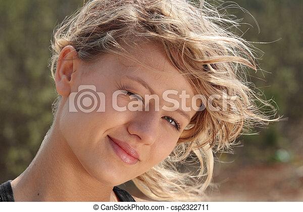 Blond fitness girl in wind portrait  - csp2322711