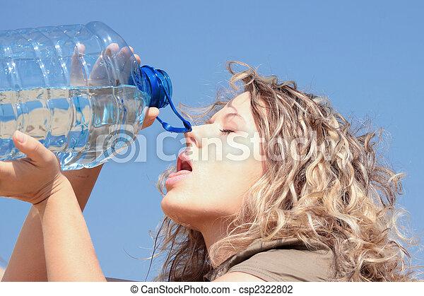 Thirsty blond woman on desert - csp2322802