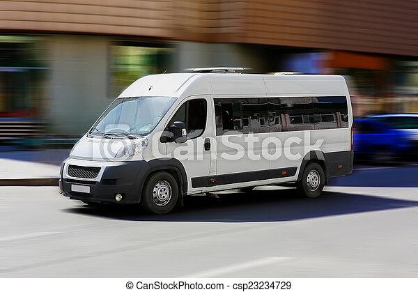 minibus goes on the city street