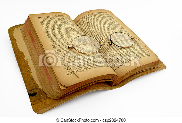 An open book with antiques gold eyeglasses                               - csp2324700