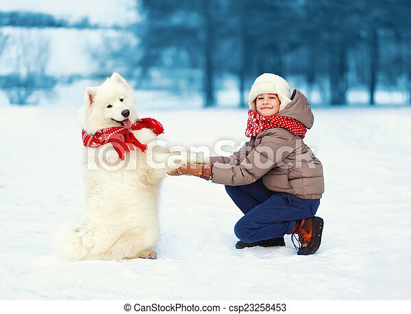 Christmas, winter and people concept - happy teenager boy playin
