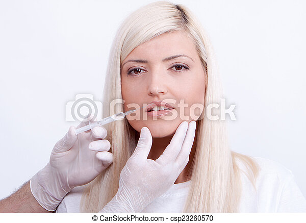 Beauty woman giving botox injections - csp23260570