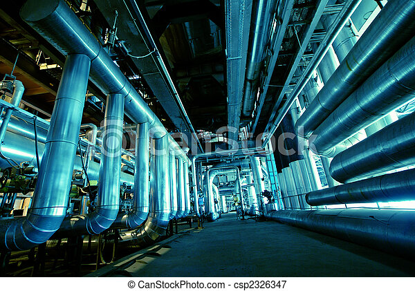 Pipes, tubes, machinery and steam turbine at a power plant - csp2326347