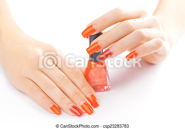 manicure. applying red nail polish. isolated