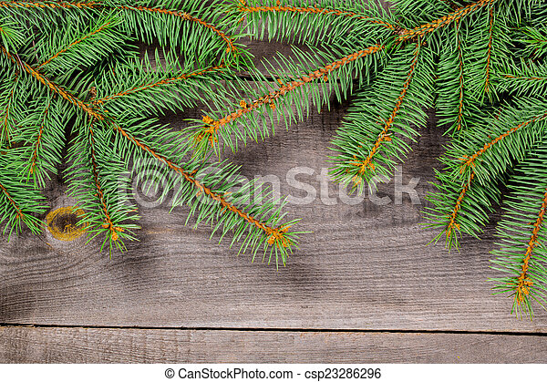 Christmas fir tree on a wooden background - csp23286296