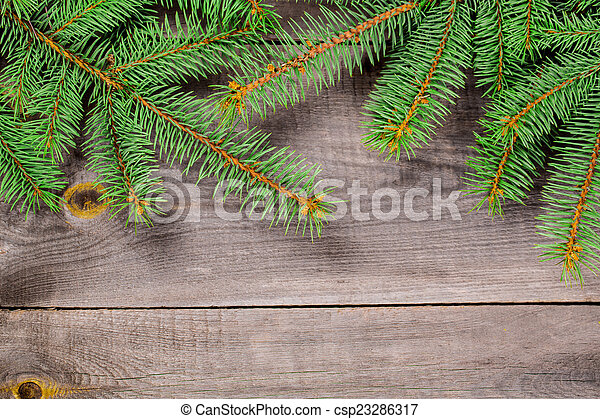 Christmas fir tree on a wooden background - csp23286317