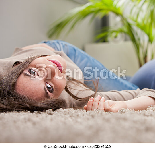 young beautiful woman smiling upside-down on the floor