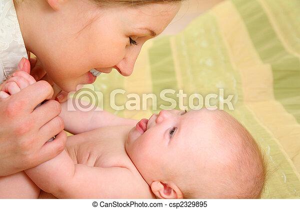 Mum has fun with the baby - csp2329895