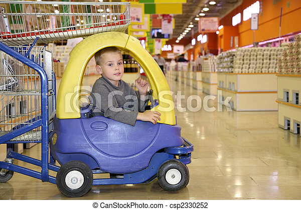 child in the toy automobile in the supermarket - csp2330252