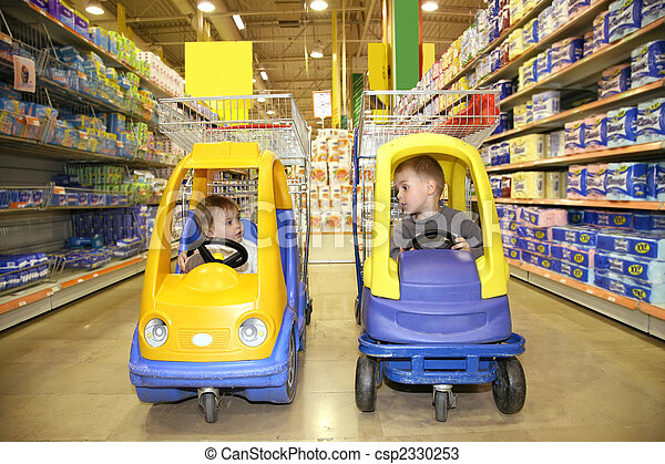 children in the toy automobiles in the store - csp2330253