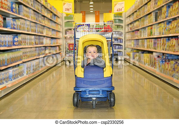 boy in the toy automobile in the supermarket - csp2330256