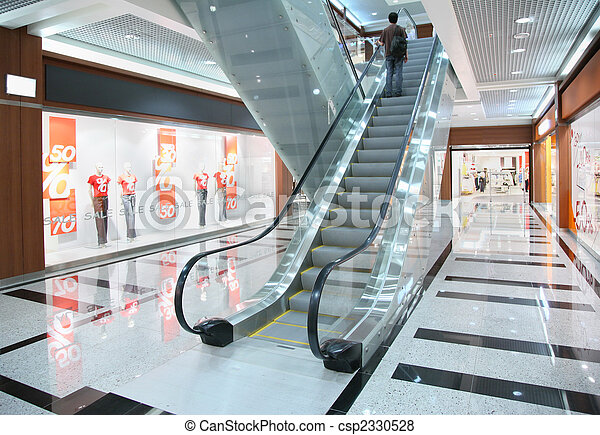 Persons on escalator in shop - csp2330528