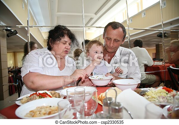 Grandmother with grandfather nourish child in canteen one - csp2330535