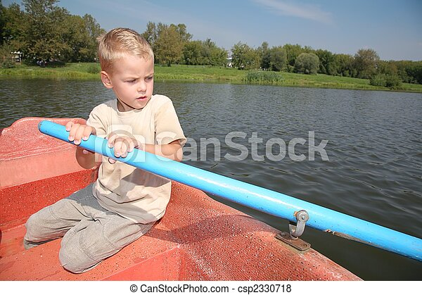 boy in the boat with the oar - csp2330718