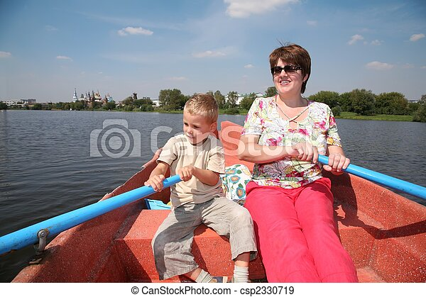 woman and boy in the boat with the oars - csp2330719