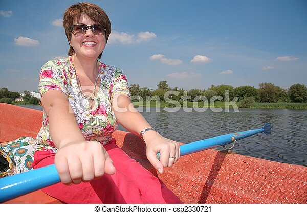 woman in the boat with the oars - csp2330721