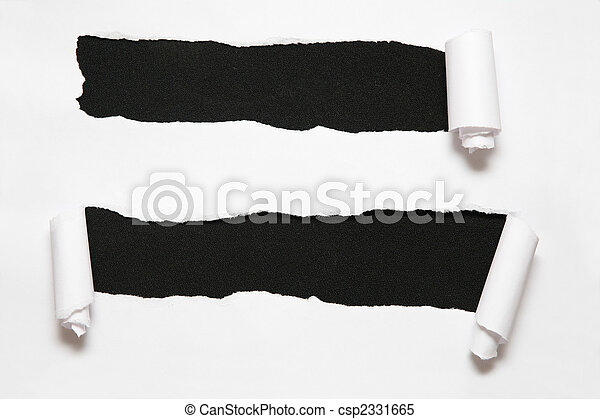 the sheet of paper with two holes against the black background - csp2331665