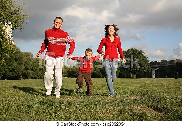 father and mother run, holding son for the hands - csp2332334