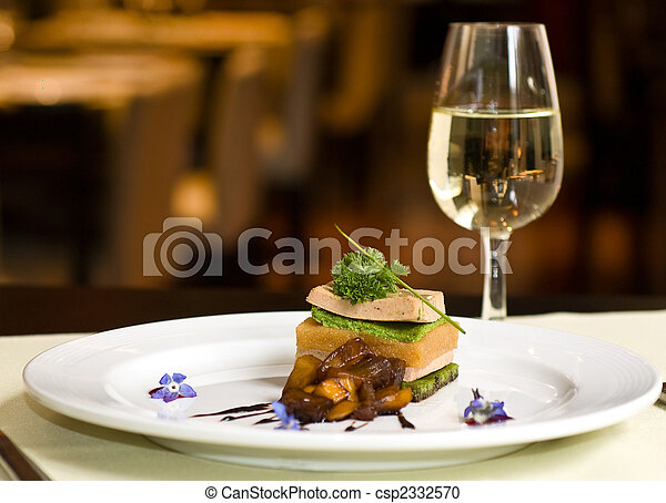 Gourmet dish and white wine, restaurant. - csp2332570