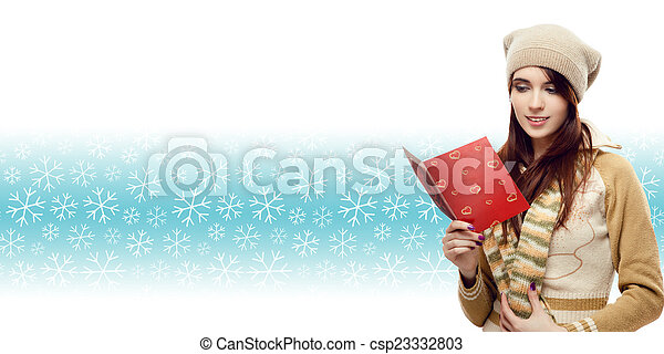woman reading christmas postcard over winter snowflakes backgrou