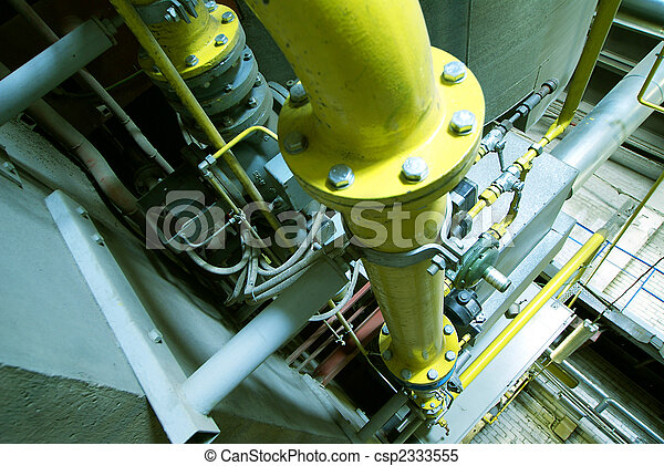 Pipes, tubes, machinery and steam turbine at a power plant - csp2333555