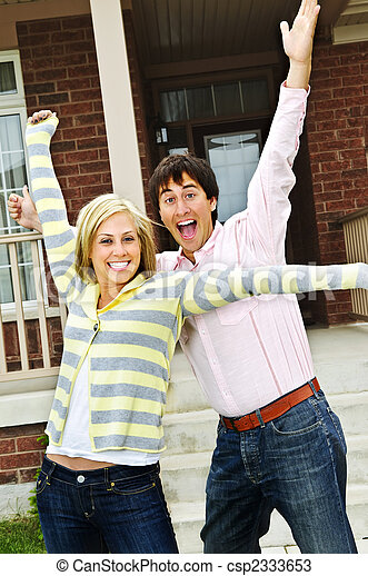 Excited couple at home - csp2333653