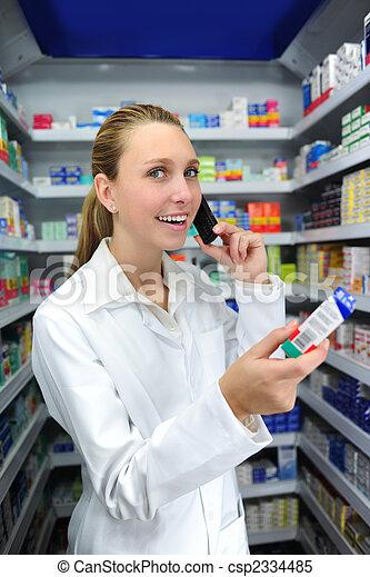 pharmacist talking on phone - csp2334485