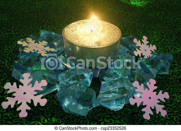 Background from candles, blue crystals and snowflakes