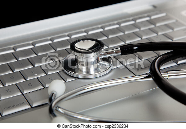 A medical stethoscope and an laptop computer - csp2336234