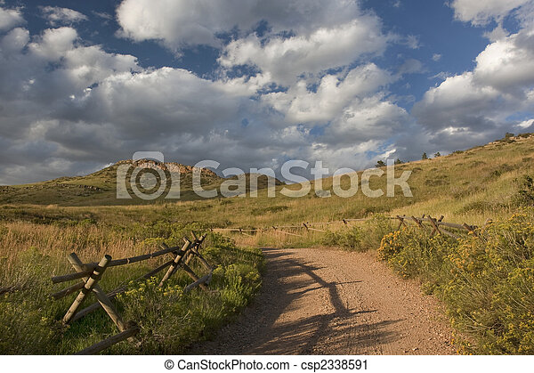 dirt road in Colorado at foothills of Rocky Mountains  - csp2338591