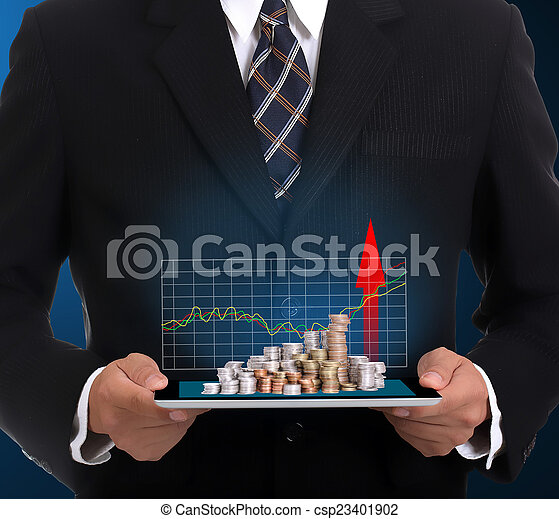 Businessman holding touch pad and growing finance